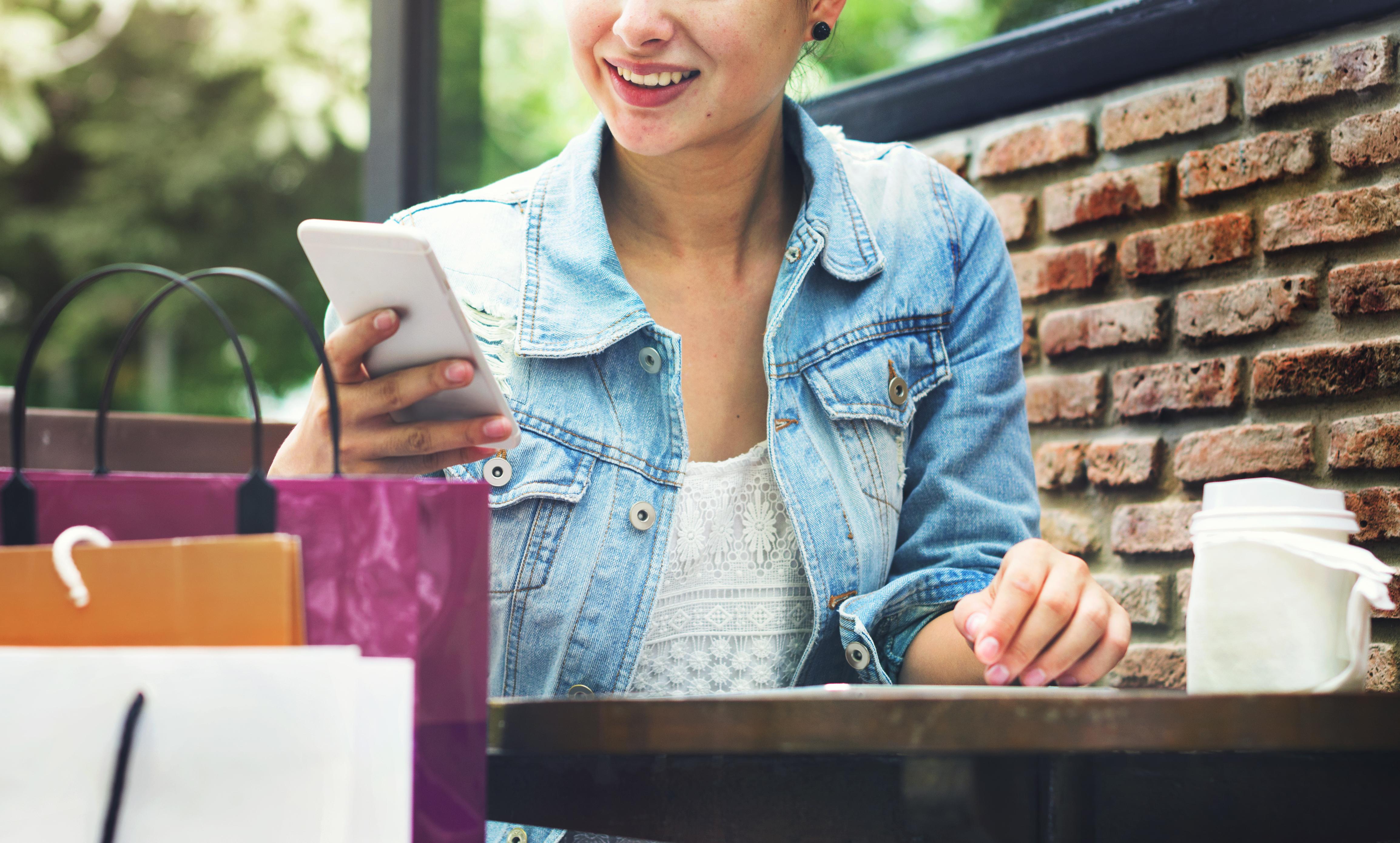 Woman Shopping Outdoor Mobile Phone Concept